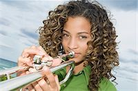 Portrait of a girl playing a trumpet Stock Photo - Premium Royalty-Freenull, Code: 6108-05862919
