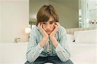 sad child sitting - Boy looking serious Stock Photo - Premium Royalty-Freenull, Code: 6108-05862966