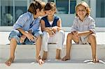 Boy kissing a girl with his friend sitting beside them Stock Photo - Premium Royalty-Free, Artist: Jim Craigmyle, Code: 6108-05863029