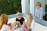 Three girls playing with toys and a boy looking at them Stock Photo - Premium Royalty-Free, Artist: Ikon Images, Code: 6108-05863035