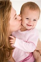 Woman kissing her daughter Stock Photo - Premium Royalty-Freenull, Code: 6108-05863170