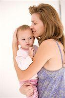 Woman hugging her daughter Stock Photo - Premium Royalty-Freenull, Code: 6108-05863242