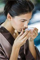 Woman smelling bath salt Stock Photo - Premium Royalty-Freenull, Code: 6108-05863531