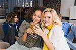 Two women toasting with wine glasses Stock Photo - Premium Royalty-Free, Artist: CulturaRM, Code: 6108-05863623
