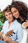Portrait of a couple playing musical instruments Stock Photo - Premium Royalty-Freenull, Code: 6108-05863639