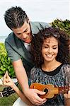 Couple playing ukulele Stock Photo - Premium Royalty-Freenull, Code: 6108-05863652