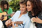 Friends playing musical instruments Stock Photo - Premium Royalty-Freenull, Code: 6108-05863658