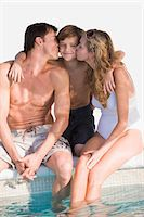 people kissing little boys - Couple kissing their son at the poolside Stock Photo - Premium Royalty-Freenull, Code: 6108-05863829