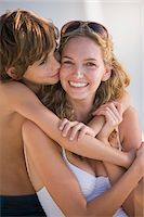 people kissing little boys - Boy kissing and hugging his mother Stock Photo - Premium Royalty-Freenull, Code: 6108-05863831
