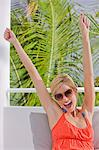 Woman laughing with her arms raised Stock Photo - Premium Royalty-Free, Artist: CulturaRM, Code: 6108-05863947