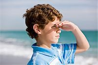 Close-up of a boy looking out to sea Stock Photo - Premium Royalty-Freenull, Code: 6108-05864092