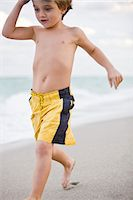 Boy running on the beach Stock Photo - Premium Royalty-Freenull, Code: 6108-05864127