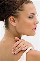 Close-up of a fashion model posing Stock Photo - Premium Royalty-Freenull, Code: 6108-05864354