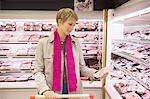 Woman shopping in a supermarket Stock Photo - Premium Royalty-Free, Artist: Andrew Douglas, Code: 6108-05864508