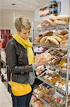 Woman choosing breads in a supermarket Stock Photo - Premium Royalty-Free, Artist: photo division, Code: 6108-05864515