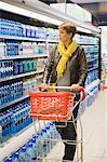 Woman buying water bottle in a store Stock Photo - Premium Royalty-Free, Artist: CulturaRM, Code: 6108-05864523