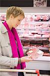 Woman shopping in a supermarket Stock Photo - Premium Royalty-Free, Artist: Cultura RM, Code: 6108-05864529