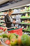Woman buying packed food in a supermarket Stock Photo - Premium Royalty-Free, Artist: Cultura RM, Code: 6108-05864536