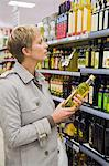 Woman buying beverages in a store Stock Photo - Premium Royalty-Free, Artist: Cultura RM, Code: 6108-05864544