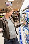 Woman buying water bottle in a store Stock Photo - Premium Royalty-Free, Artist: CulturaRM, Code: 6108-05864553