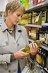 Woman buying beverages in a store Stock Photo - Premium Royalty-Free, Artist: Ikon Images, Code: 6108-05864559