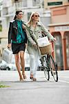 Two women walking with shopping bags Stock Photo - Premium Royalty-Free, Artist: CulturaRM, Code: 6108-05864613