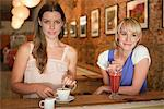 Two women having beverages in a cafe Stock Photo - Premium Royalty-Free, Artist: Blend Images, Code: 6108-05864619
