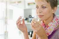 smelly - Woman smelling perfume in a store Stock Photo - Premium Royalty-Freenull, Code: 6108-05864696