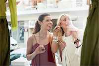 Two women window shopping outside a store Stock Photo - Premium Royalty-Freenull, Code: 6108-05864744