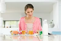 fat lady sitting - Woman having breakfast at a table Stock Photo - Premium Royalty-Freenull, Code: 6108-05864951