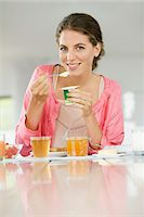 fat lady sitting - Woman having breakfast at a table Stock Photo - Premium Royalty-Freenull, Code: 6108-05864953