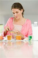 fat lady sitting - Woman having breakfast at a table Stock Photo - Premium Royalty-Freenull, Code: 6108-05864958