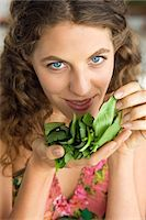 smelly - Woman smelling spinach leaves in the kitchen Stock Photo - Premium Royalty-Freenull, Code: 6108-05864964