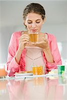 fat lady sitting - Woman having breakfast at a table Stock Photo - Premium Royalty-Freenull, Code: 6108-05864979