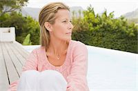 Woman sitting on a terrace Stock Photo - Premium Royalty-Freenull, Code: 6108-05865135