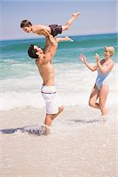 Family playing on the beach Stock Photo - Premium Royalty-Freenull, Code: 6108-05865139