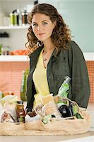 Portrait of a woman working in the kitchen Stock Photo - Premium Royalty-Freenull, Code: 6108-05865411