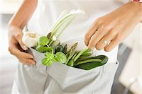 ring hand woman - Woman standing with vegetables in the kitchen Stock Photo - Premium Royalty-Freenull, Code: 6108-05865412