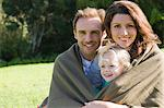 Portrait of a family smiling Stock Photo - Premium Royalty-Free, Artist: Robert Harding Images, Code: 6108-05865853