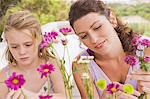 Woman with her daughter arranging flowers Stock Photo - Premium Royalty-Free, Artist: Robert Harding Images, Code: 6108-05865877