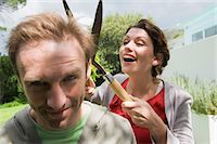 funny looking people - Woman cutting man's hair with a hedge clipper Stock Photo - Premium Royalty-Freenull, Code: 6108-05865882