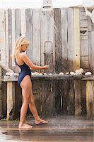 Girl under a beach shower Stock Photo - Premium Royalty-Freenull, Code: 6108-05865930