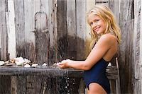 Portrait of a girl under a beach shower Stock Photo - Premium Royalty-Freenull, Code: 6108-05865931
