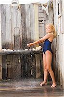 Girl under a beach shower Stock Photo - Premium Royalty-Freenull, Code: 6108-05865970