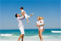 families playing on the beach - Family enjoying vacations on the beach Stock Photo - Premium Royalty-Freenull, Code: 6108-05865993
