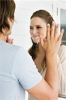 Couple looking at each other and smiling Stock Photo - Premium Royalty-Freenull, Code: 6108-05866179