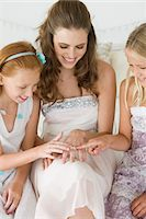 ring hand woman - Bride showing her wedding ring to girls Stock Photo - Premium Royalty-Freenull, Code: 6108-05866262