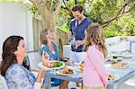 Family having breakfast at the dining table Stock Photo - Premium Royalty-Free, Artist: Cultura RM, Code: 6108-05866332