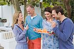 Four friends eating fruits and having fun Stock Photo - Premium Royalty-Free, Artist: Jodi Pudge, Code: 6108-05866338