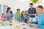 Family having breakfast at the dining table Stock Photo - Premium Royalty-Free, Artist: Blend Images, Code: 6108-05866341